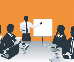 A group of co-workers attending a business meeting with an orange background